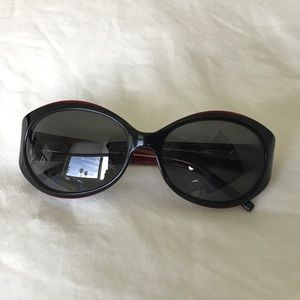 Red rimmed acrylic black sunglasses